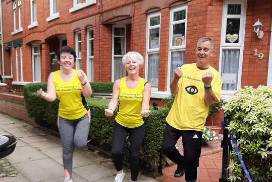 Lee Family in yellow tops, outside house