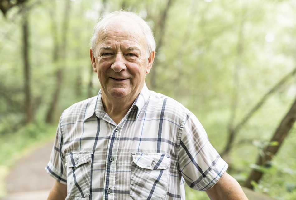 Elderly man smiling outside