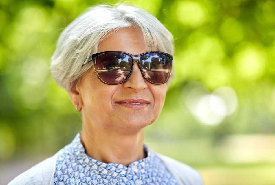 Lady outside wearing sunglasses