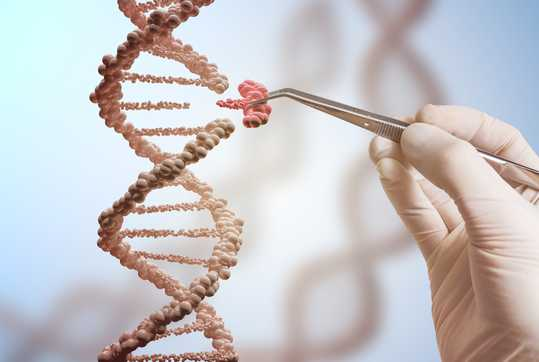 DNA molecules with person holding tweezers
