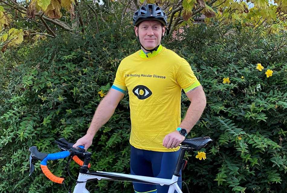 Simon Jones in Macular Society top, with cycle.