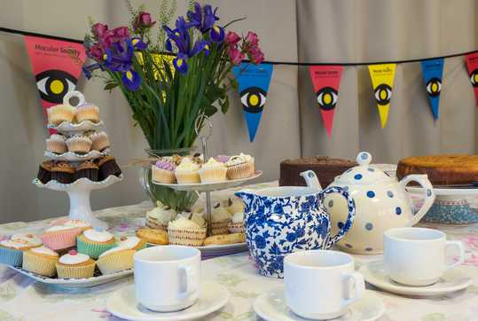 Tea set, bunting, flowers and lots of cakes