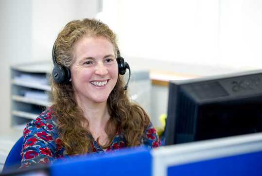 staff member on phone smiling
