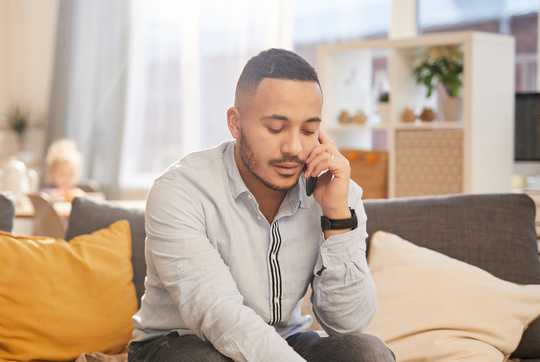 Man on phone counselling