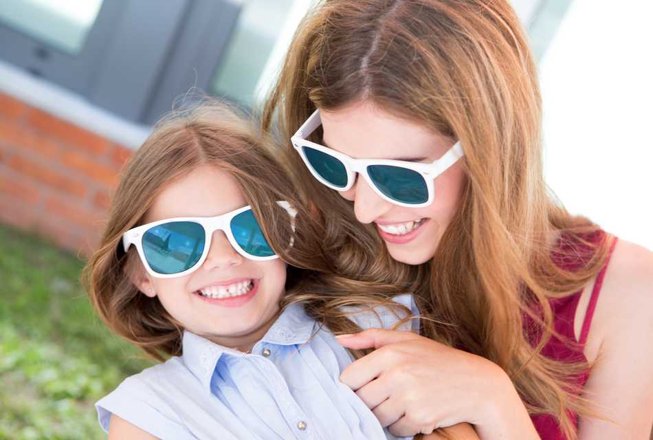 Mother and daughter in sunglasses