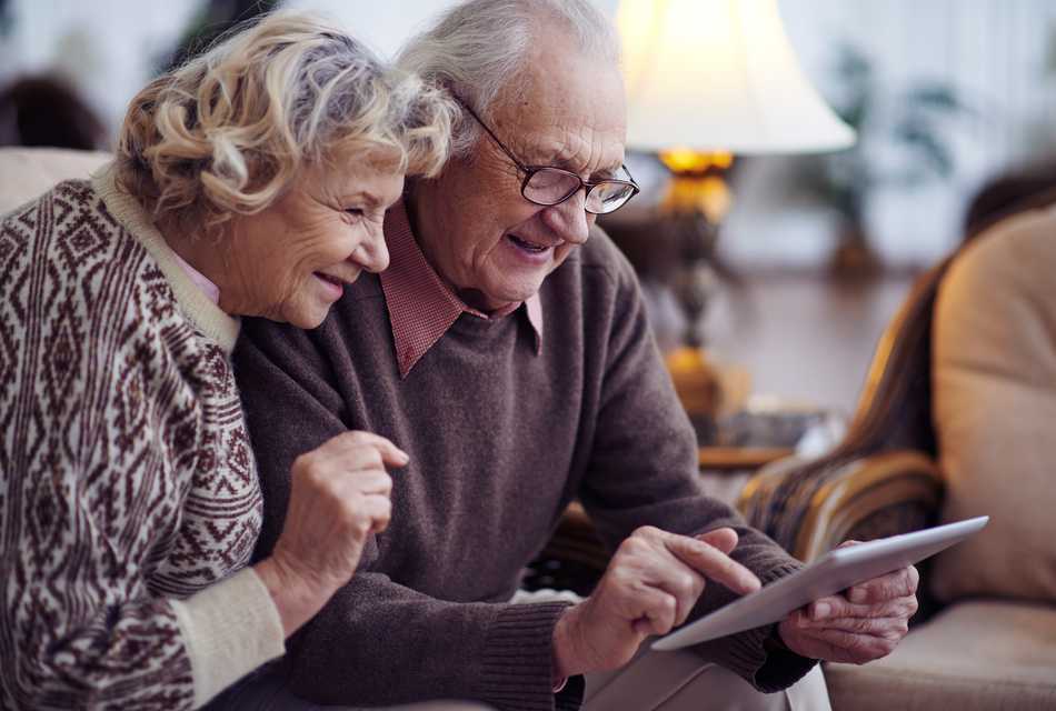 Elderly couple looking at a tablet