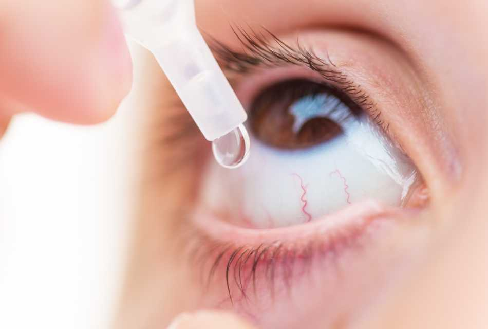Eye drop being instilled into eye.