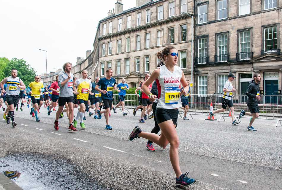 Runners in Edinburgh with one in the lead