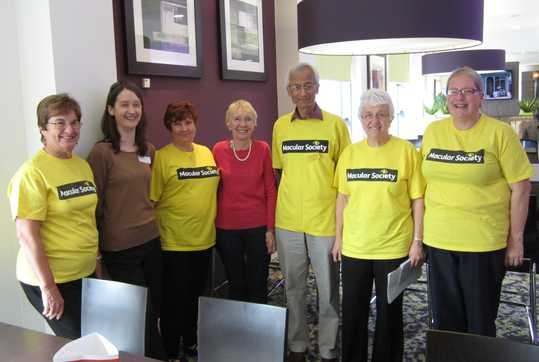 Group picture of some volunteers in yellow t-shirts