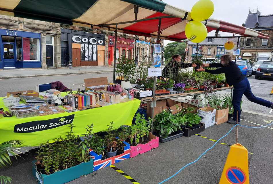 Fundraising market stall with plants in street