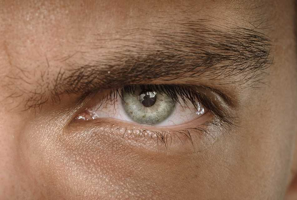 Man with green eyes close up