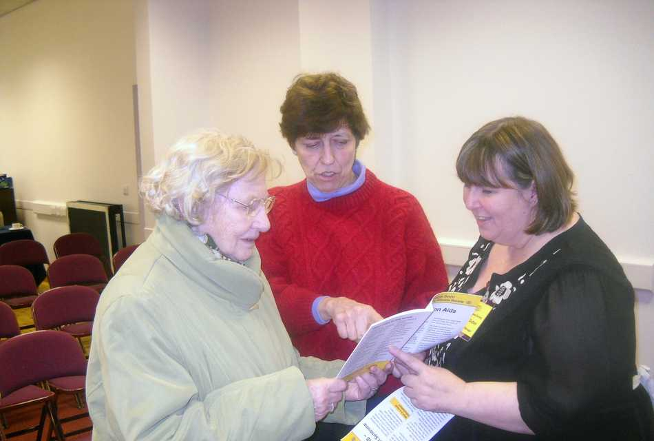 Ladies in a group looking at leaflet