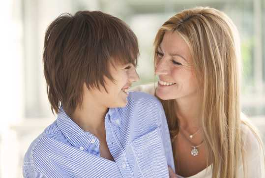 Mother and son smiling