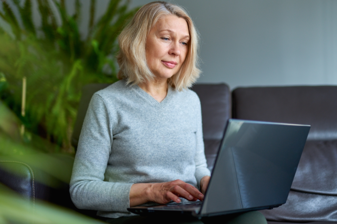 Woman with laptop working
